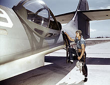 Airplane Picture - PBY waist gunner mounting port side gun blister.