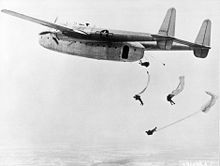 Airplane Picture - Fairchild C-82 Packet dropping paratroops in training exercise