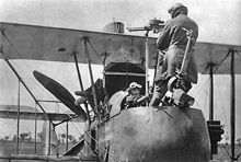 Airplane Picture - An F.E.2d observer demonstrating the use of the rear-firing Lewis gun which required him to stand on his seat.