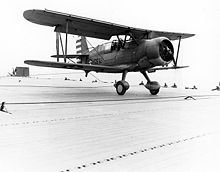 Airplane Picture - SOC-3A Seagull touches down on USS Long Island in April 1942, celebrating the carrier's 2000th landing