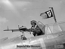 Airplane Picture - The sergeant air gunner of a Battle mans the aircraft's defensive weapon, a single pintle-mounted rapid firing Vickers K machine gun, France 1940