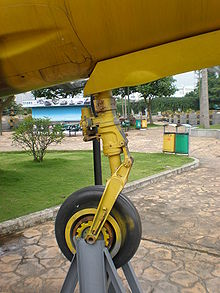 Airplane Picture - The front landing gear of the yellow J-7