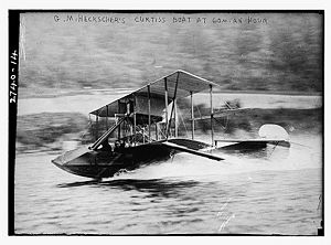 Airplane Picture - Gustave Maurice Heckscher in his Curtiss seaplane at 60 miles per hour circa 1912