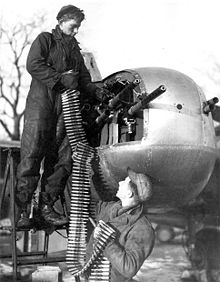 Aircraft Picture - Re-loading machine guns on an A-26B with a six-gun nose
