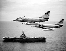 Aircraft Picture - VA-146 A-4Cs over the Gulf of Tonkin in August 1964. USS Kearsarge (CV-33) steams below.