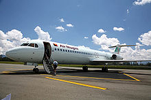 Aircraft Picture - An Air Niugini Fokker 100 (P2-ANH) parked at Mt. Hagen's Kagamuga Airport, Papua New Guinea.