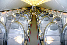 Aircraft Picture - British Airways Concorde interior before 2000. The narrow fuselage needed for efficient supersonic flight permitted only 4 seats across the aircraft, and gave limited headroom and locker space.