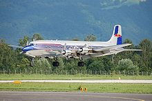 Aircraft Picture - The Red Bull DC-6B landing at Salzburg