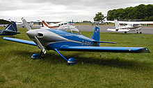 Aircraft Picture - A general aviation scene at Kemble Airfield, England. The aircraft in the foreground is a homebuilt Vans RV-4