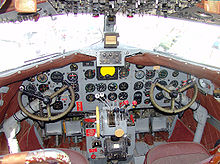 Aircraft Picture - Cockpit of DC-3 operated by FAA to verify operation of navaids (VORs and NDBs) along federal airways
