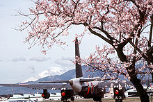 Aircraft Picture - A Japanese P-2J (note the twin-wheel main gear) framed by cherry blossoms at the Naval Air Facility, Atsugi, Japan in 1985