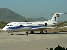 Aircraft Picture - One of Vietnam Airlines's two Fokker 70s on the ground at Luang Prabang International Airport, Laos.
