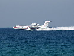 Aircraft Picture - Beriev Be-200 filling water tanks in the Mediterranean Sea while in operation in Mount Carmel forest fire in Israel
