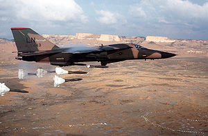 Aircraft Picture - An F-111F of the 494th Tactical Fighter Squadron releasing its load of Mark 82 high-drag bombs over the Bardenas Reales range in Navarre, Spain, in 1986