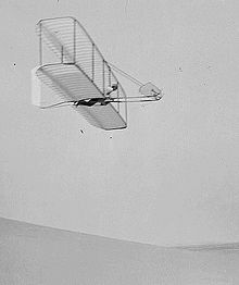 Aviation History - The Wright Brothers - Wilbur Wright pilots the 1902 glider over the Kill Devil Hills, October 10, 1902. The single rear rudder is steerable; it replaced the original fixed double rudder.