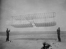 Airplane Picture - Wilbur (left) and Orville flying their 1901 glider as a kite