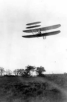Aviation History - The Wright Brothers - Wright Flyer III piloted by Orville over Huffman Prairie, October 4, 1905. Flight #46, covering 20 and 3/4 miles in 33 minutes 17 seconds; last photographed flight of the year
