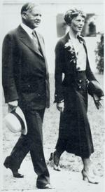 Aviation History - Earhart walking with President Hoover in the grounds of the White House on January 2, 1932