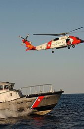 Helicopter Picture - HH-60J Jayhawk (USCG Registration Number 6034) and a 47-foot motor life boat
