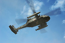 Helicopter Picture - US Army UH-60A MEDEVAC evacuating simulated casualties during a training exercise