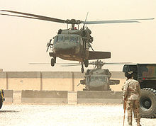 Helicopter Picture - UH-60s equipped with M60 machine guns near An Najaf, Iraq in May 2005.