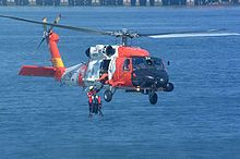Helicopter Picture - HH-60J Jayhawk (USCG Registration Number 6022) retrieving a rescue swimmer.