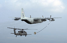 Helicopter Picture - USAF HC-130P of the 920th Rescue Wing refuels an HH-60 Pave Hawk.