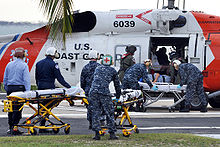 Helicopter Picture - Victims from the 2010 Haiti earthquake are unloaded from a HH-60J Jayhawk (USCG Registration Number 6039) at U.S. Naval Hospital Guantanamo Bay, Cuba.