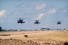 Helicopter Picture - UH-60A Black Hawks over Port Salinas during the invasion of Grenada, 1983. The conflict saw the first use of the UH-60.