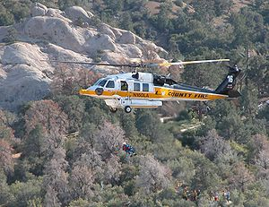 Helicopter Picture - Los Angeles County Fire Department S-70A Firehawk rescuing an injured hiker at Devil's Punchbowl near Palmdale, California