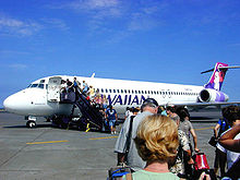 Airplane Picture - A Hawaiian Airlines 717 boarding at Kona International Airport, Hawaii for an interisland flight in 2004.