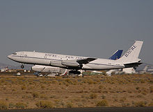 Airplane Picture - Omega Air's 707-330C testbed for the 707RE program takes off from the Mojave Airport