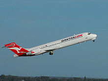 Airplane Picture - A QantasLink 717 departs Perth Airport, Australia in 2007.