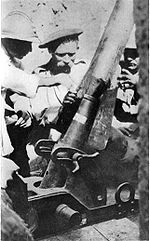 World War 1 Picture - Frenchman instructing Serbian in Use of Trench Mortar, 1916-1917.
