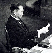 World War 1 Picture - Yonai reading a memo during the House plenary session in February 1940.