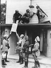 World War 1 Picture - German troops remove Polish insignia at the Polish-Danzig border near Zoppot on 1 September 1939