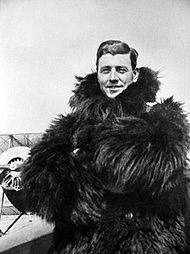 World War 1 Picture - Dallas wearing one of the thick fur coats used by World War I aviators to protect against the severe cold experienced in planes with open cockpits