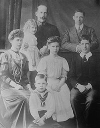 World War 1 Picture - Constantine with his family, ca. 1910. Top left: the king holding the toddler Princess Irene. Top right: the future George II. Left: Queen Sophia. Center: Princess Helen. Right: the future Alexander I. Front: the future Paul I. Princess Katherine is yet unborn.