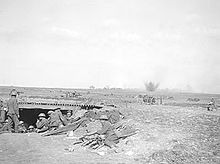 World War 1 Picture - British 18-pounder battery under German fire close to Monchy-le-Preux, 24th April. In the foreground is an advanced dressing station