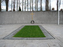World War 1 Picture - The burial spot of the Leaders of the Rising, in the old prison yard of Arbour Hill prison. The memorial was designed by G. McNicholl. The Proclamation of 1916 is inscribed on the wall in both Irish and English