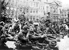World War 1 Picture - British troops from 4th Royal Fusiliers resting in the square at Mons 22 August 1914, the day before the Battle of Mons