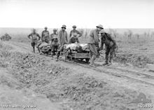 World War 1 Picture - 5th Australian Field Ambulance Company soldiers evacuating wounded from the front near Ypres in trench railway hand cars.
