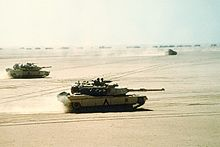 World War 1 Picture - A combined force of M1 Abrams tanks, Bradley IFVs and a logistical convoy advancing during the Gulf War