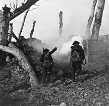 World War 1 Picture - Two U.S soldiers run toward a bunker past the bodies of two German soldiers during World War I. Digitally restored.