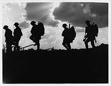 World War 1 Picture - British soldiers moving forward during the Battle of Broodseinde. Photo by Ernest Brooks.