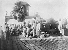 World War 1 Picture - Loading of cotton bales on the pier at Lome (1885)