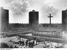 World War 1 Picture - Hindenburg's original 1934 burial at the Tannenberg Memorial. Hitler is speaking at the lectern.