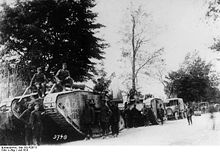 World War 1 Picture - Captured British Mark IV tanks used by German troops.