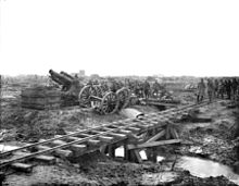 World War 1 Picture - BL 9.2 inch Howitzer with shells lined up on the ground recently delivered from the trench railway in the foreground.