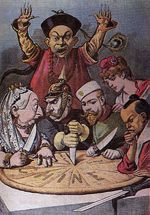 World War 1 Picture - China imperialism cartoon-while a Mandarin official helplessly looks on, China as a pie is about to be carved up by Queen Victoria (British Empire), Wilhelm II (German Empire), Nicolas II (Russian Empire), Marianne (France), and a samurai (Japanese Empire)